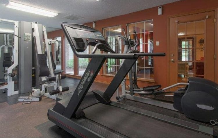 Fitness center for residents with individual workout stations at The Regent in Dallas, Texas
