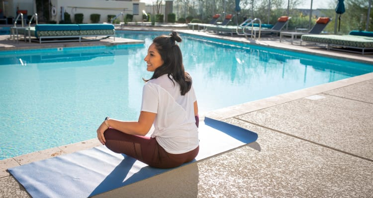 Resident meditating by the pool at Tempe Metro in Tempe, Arizona