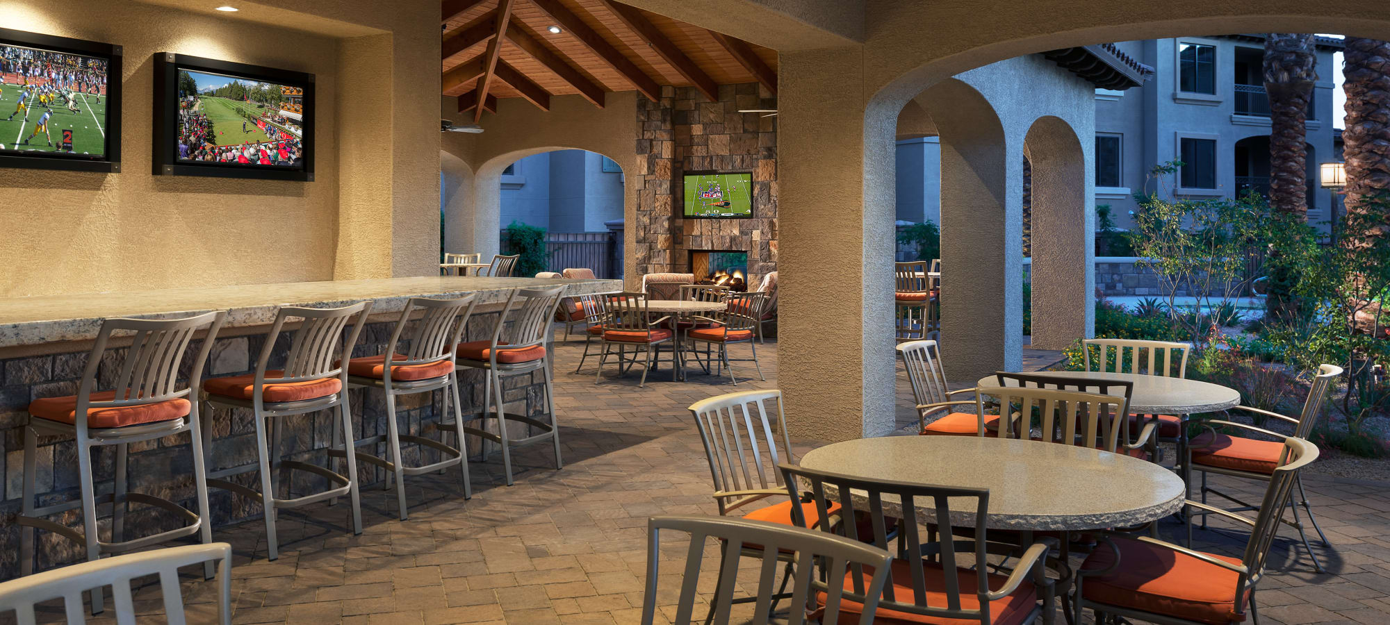 Poolside covered patio with a bar at San Portales in Scottsdale, Arizona