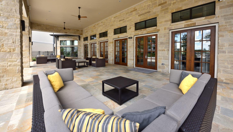 Comfortable outdoor patio seating at Olympus Falcon Landing in Katy, Texas
