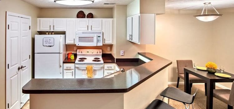 Modern kitchen and dining area at Waterford Nevillewood Apartments