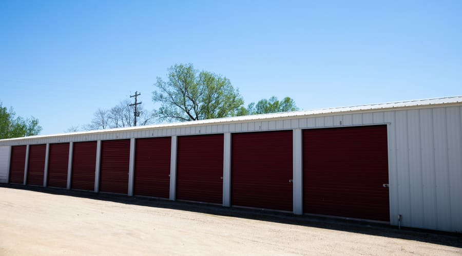 Outdoor storage units with brown doors at KO Storage of Tomah - Superior Ave in Tomah, Wisconsin