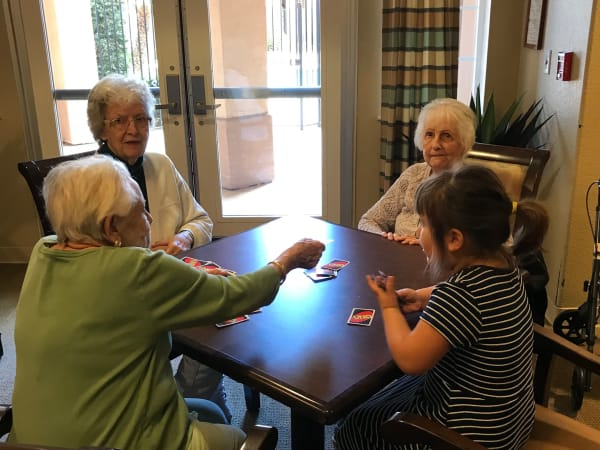 Residents and family playing a game at The Lakes at Banning in Banning, California.