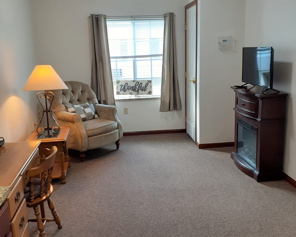 Comfortable living room in one bedroom apartment at Clover Ridge Place in Maquoketa, Iowa.