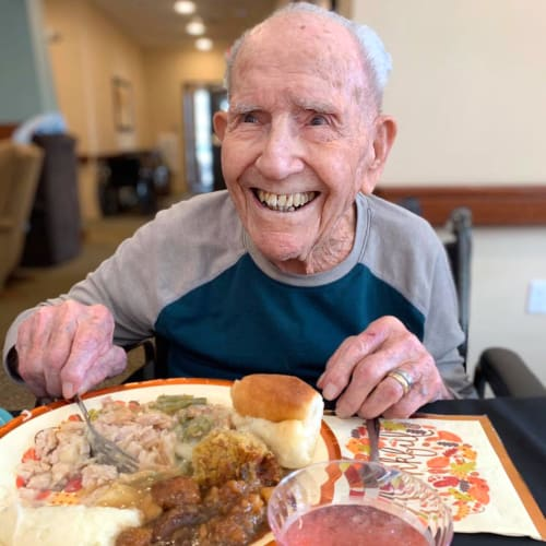 Resident with a plate of desert at Oxford Glen Memory Care at Owasso in Owasso, Oklahoma