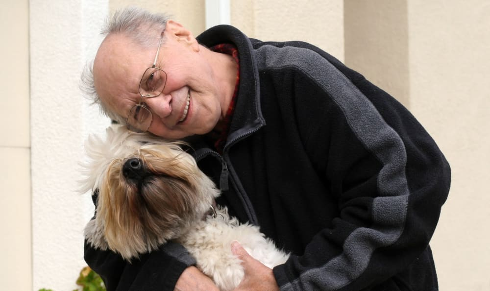 Resident and his dog at our pet-friendly senior care community at St. Anthony's Senior Living