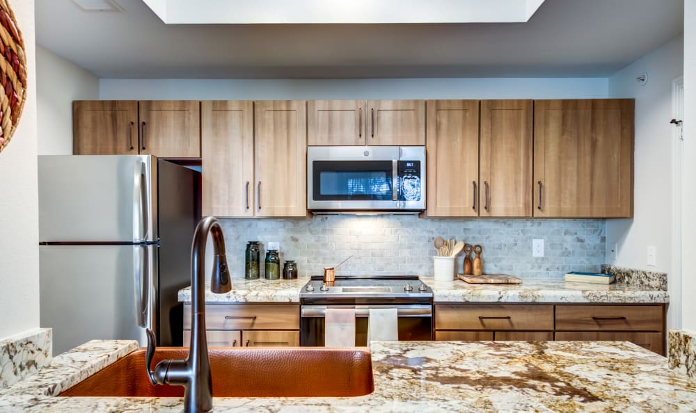 Attractive kitchen with a skylight at Riata Austin in Austin, Texas