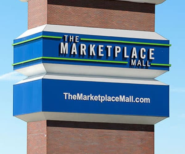 Shopping mall in West Henrietta, New York near Riverton Knolls