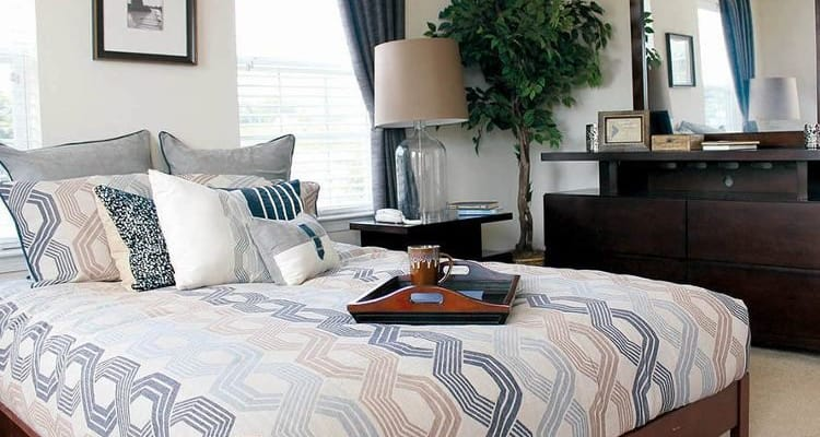 Enjoy apartments & townhomes with a cozy bedroom at The Encore at Laurel Ridge