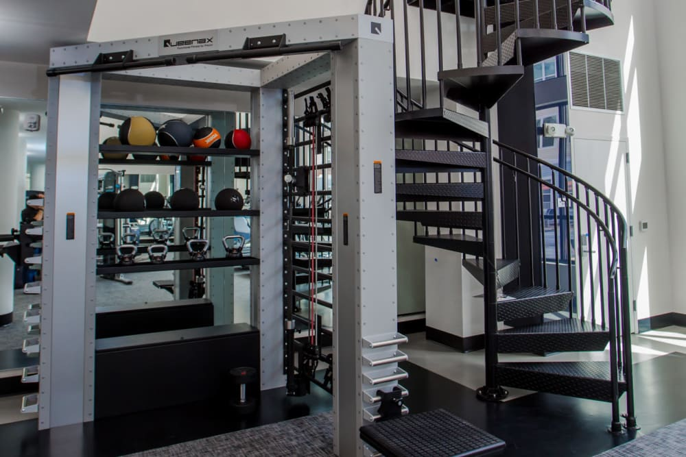 Weights and staircase in Fitness Center at The Mark Parsippany in Parsippany, New Jersey