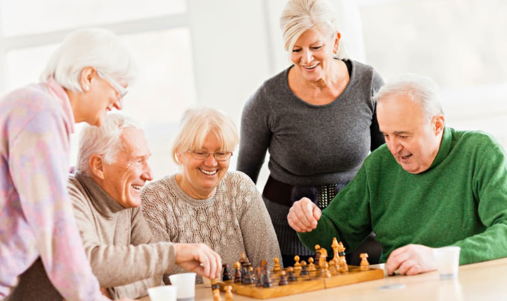 Residents playing chess at St. Anthony's Senior Living