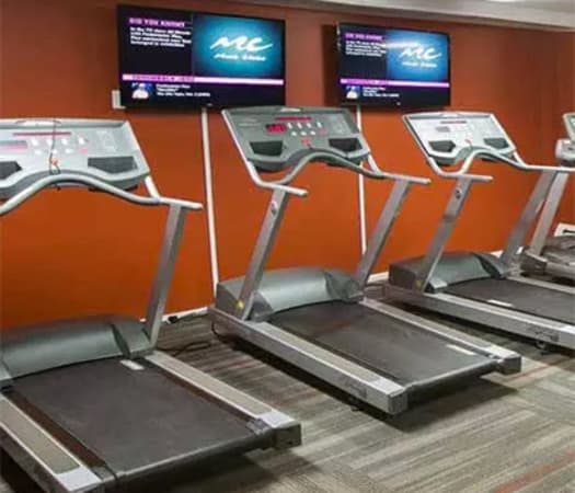 Fully equipped fitness center at Solon Club Apartments in Oakwood Village, Ohio