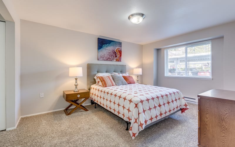 Spacious master bedroom with plush carpeting at Cascade Ridge in Silverdale, Washington