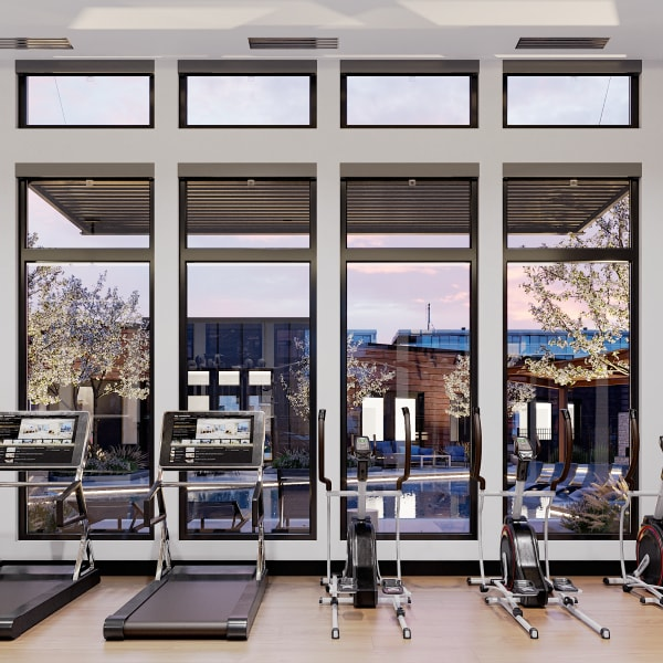 Cardio stations with pool views at Solana Stapleton Apartments in Denver, Colorado