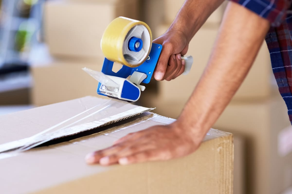 A man packing a box at Carolina Secure Storage in Henderson, North Carolina