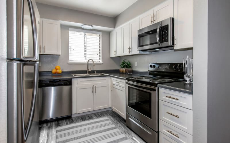 Renovated kitchen with stainless-steel appliances at Bennington Apartments in Fairfield, California