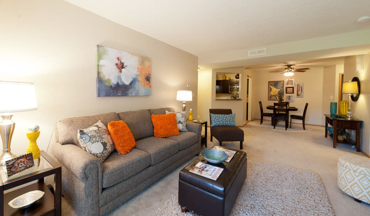 A large living room with plush carpeting at Pointe West Apartment Homes in West Des Moines, Iowa
