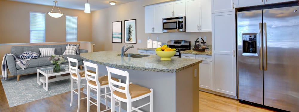 An open floor plan shows off the kitchen and living room at Palisades Sierra Del Oro in Corona, California