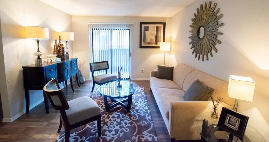 Beautiful living room at Promenade at Valley Creek in Irving, TX