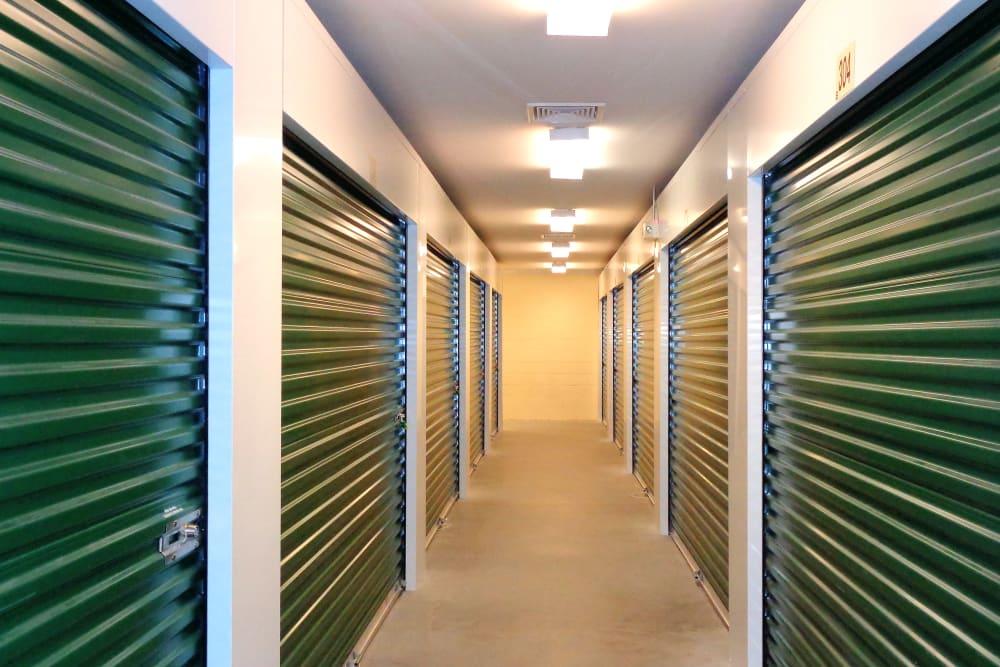 Well lit hallway of storage units at Capital Self Storage in Harrisburg, PA