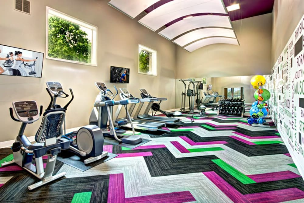 Fitness center with plenty of individual workout stations at Wellington Apartment Homes in Silverdale, Washington