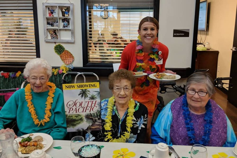 Residents wearing leis for Hawaiian theme day at Valley View Health Campus in Fremont, Ohio