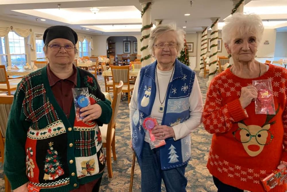 Residents in fun Christmas sweaters at Brentwood at Niles in Niles, Michigan