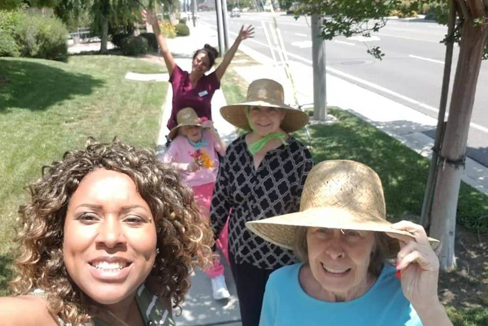 Residents and staff out for a walk near Sunlit Gardens in Alta Loma, California