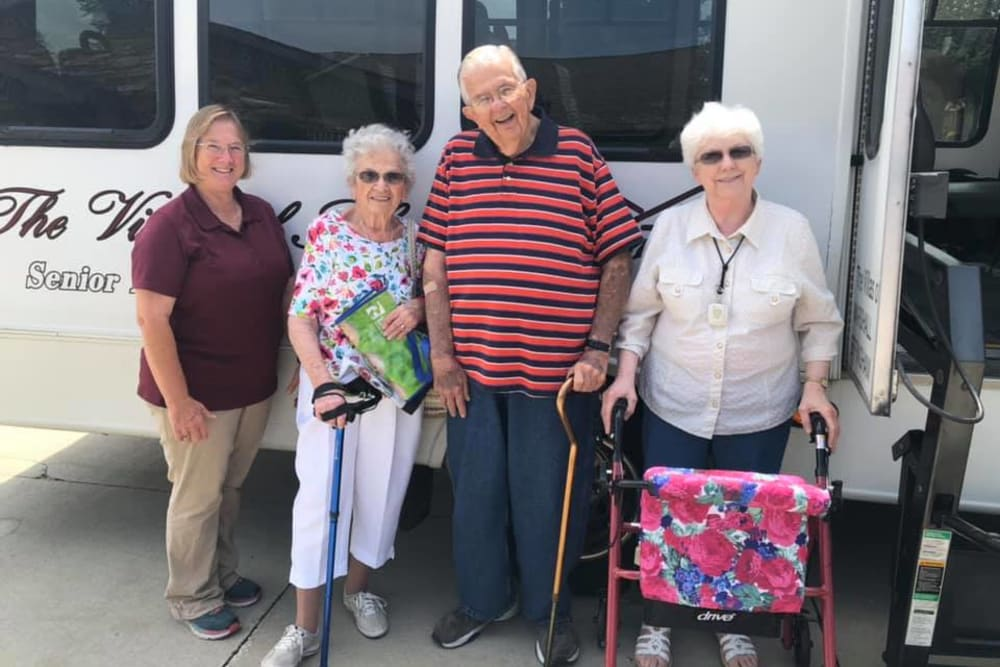 Residents in front of the bus ready to go on an outing from Villas of Holly Brook Effingham in Effingham, Illinois