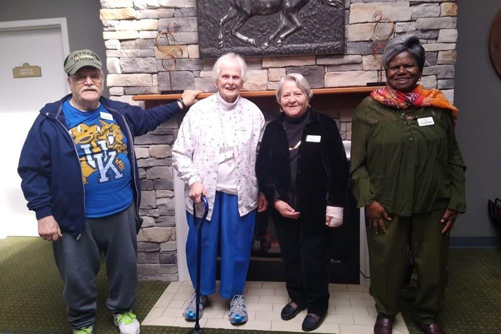 Team of ambassadors around the fireplace at Willow Creek Senior Living in Elizabethtown, Kentucky.
