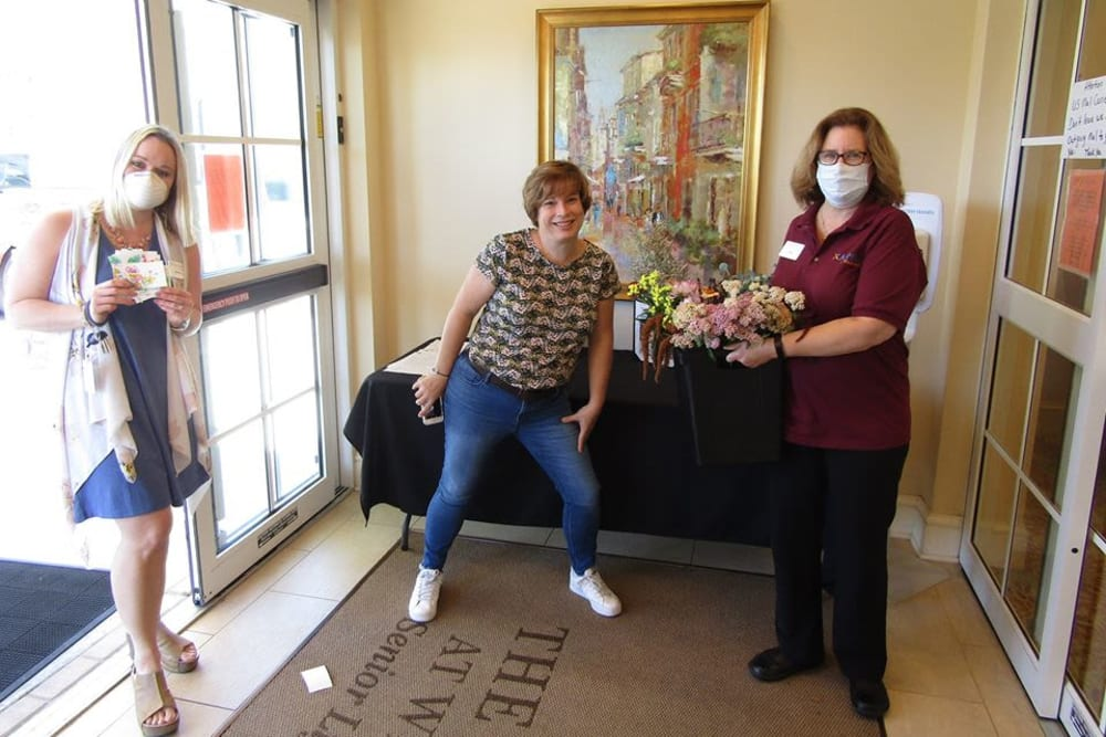 Employees with flowers at Azpira at Windermere in Windermere, Florida