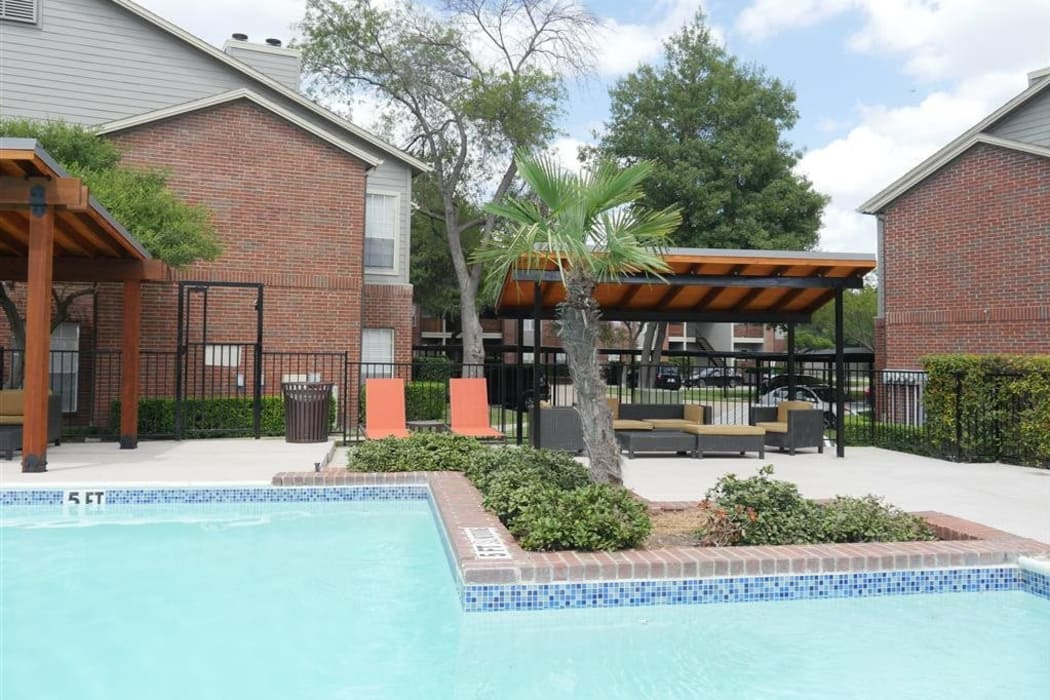 Gorgeous swimming pool area on a beautiful day at Veridian Place in Dallas, Texas