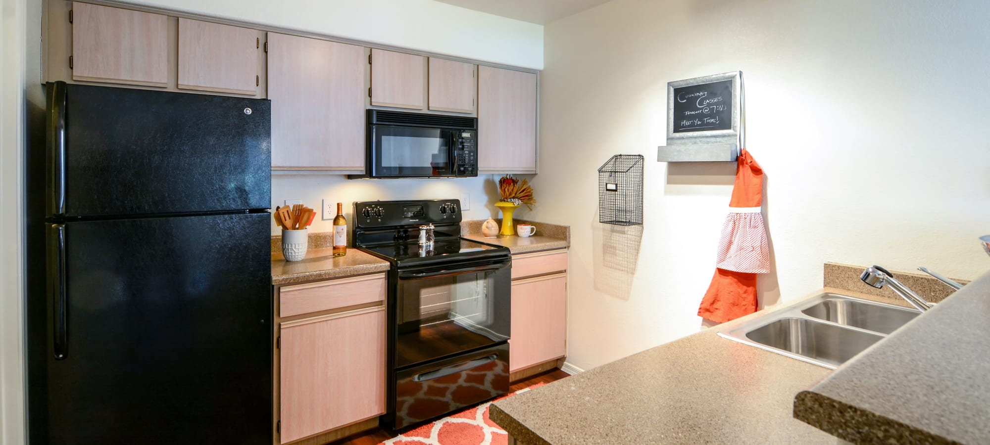 Kitchen with orange hand towel at The Palms on Scottsdale in Tempe, Arizona