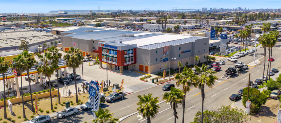 Large palm trees surround the facility in National City, California at A-1 Self Storage
