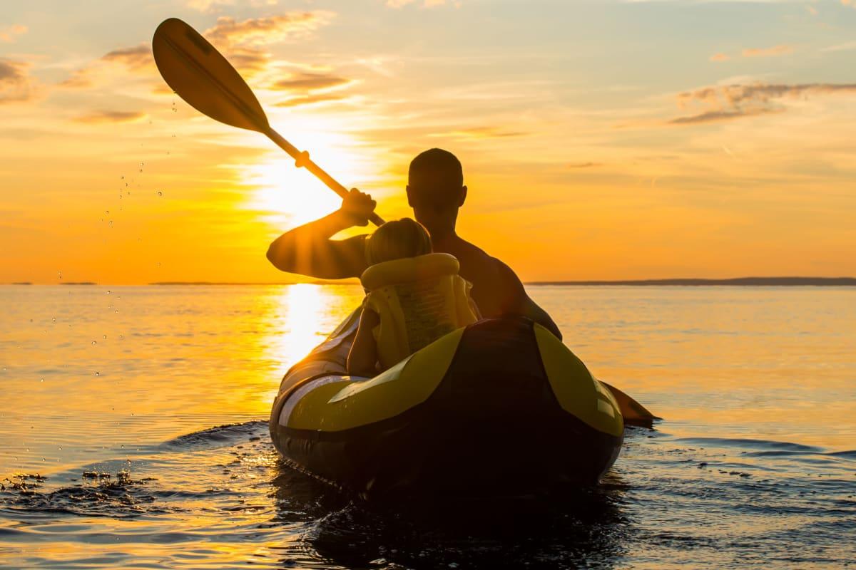 Resident and his son kayaking at sunset near Marina Harbor in Marina del Rey, California