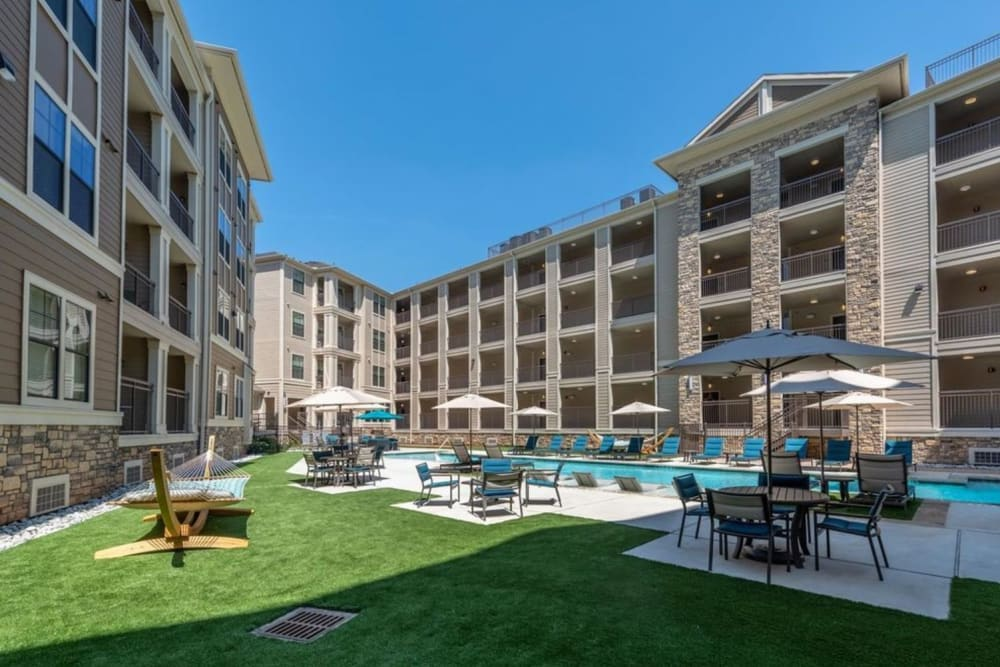 Sparkling swimming pool and plenty of patio seating in the courtyard at Heights West 11th in Houston, Texas