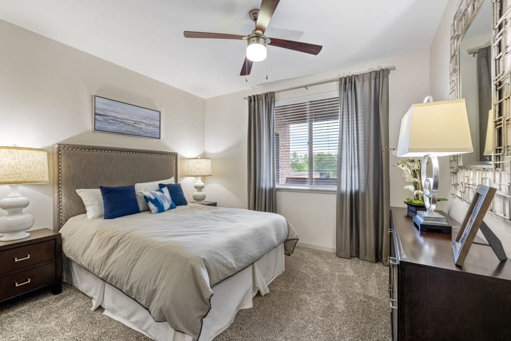 Spacious bedroom with ceiling fan at The Parc at Greenwood Village in Greenwood Village, Colorado