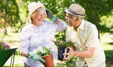 Two residents gardening at Arbors Memory Care in Sparks, NV