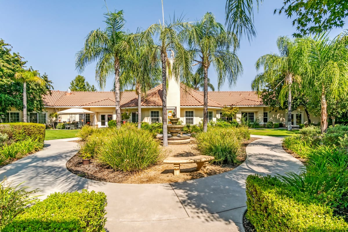 Beautiful patio with water fountain at Cottonwood Court in Fresno, California