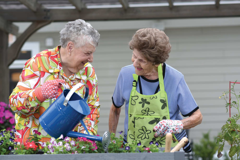 Two senior ladies gardening at The Atrium at Serenity Pointe in Hot Springs, Arkansas
