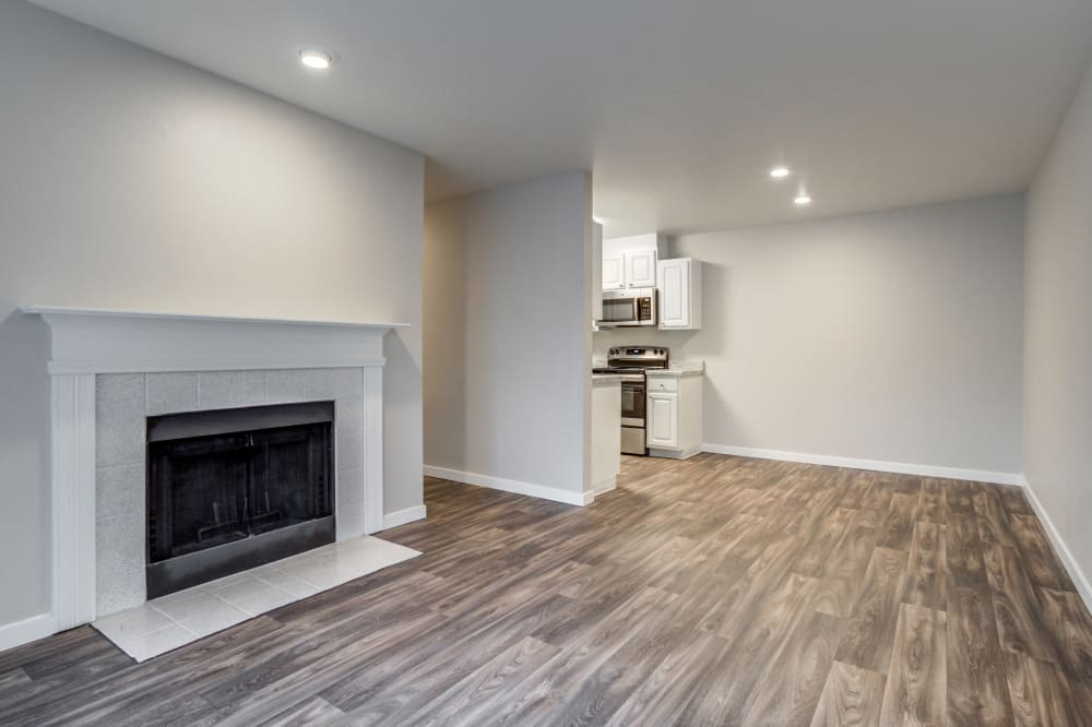 Living area and fireplace at Walden Pond Apartments in Everett, Washington