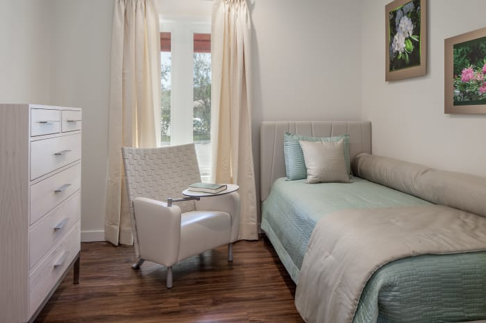 Twin bed with a spot for a care taker at All Seasons Naples in Naples, Florida