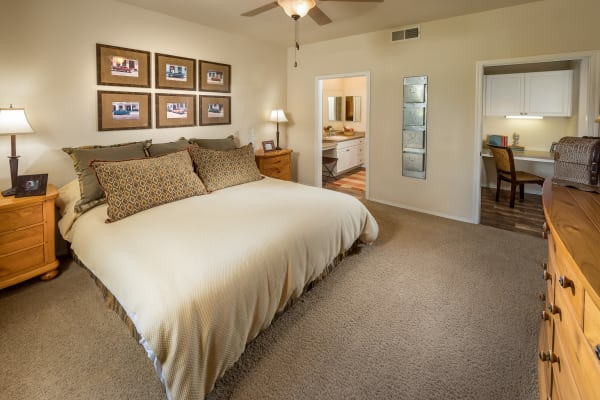 Model bedroom with a ceiling fan at Stone Oaks in Chandler, Arizona