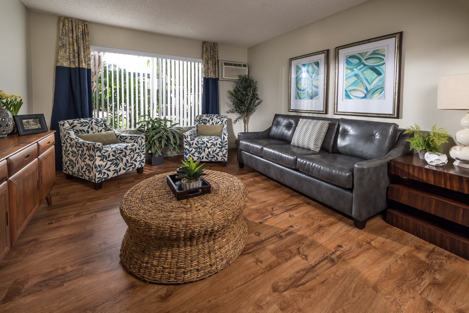 Spacious living rooms at UCE Apartment Homes in Fullerton, California, complete with hardwood floors