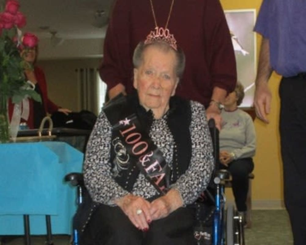 Resident Jane celebrates her 100th birthday at his dare to dream event from Milestone Senior Living in Tomahawk, Wisconsin.