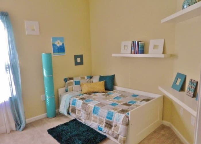 Autumn View Apartments offers a cozy bedroom in Fayetteville, North Carolina