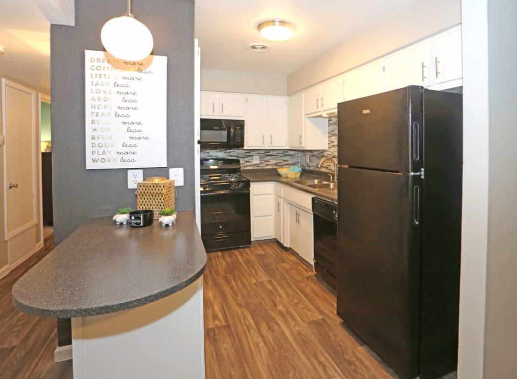 Kitchen features granite countertops at Casa Tierra in Albuquerque, New Mexico