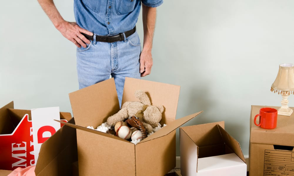 Man packing boxes at Aarons Self Storage in Texas