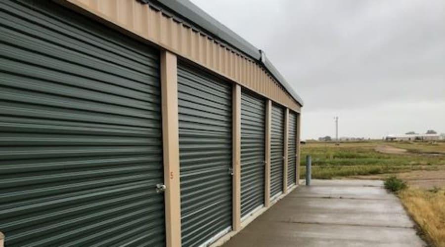Storage units with green doors and locks at KO Storage of Elk Point in Elk Point, South Dakota