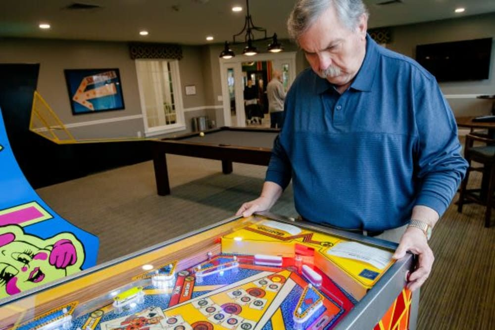 A resident playing pinball at Mercer Hill at Doylestown in Doylestown, Pennsylvania